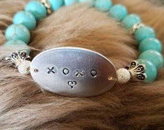 Embellished Tiffany blue/ turquoise,  and rhinestone beaded bracelet w/ XOXO on handstamped silver plate