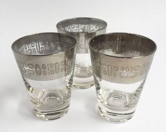 Chrome rimmed atomic pattern bar glasses