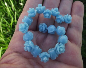5 BLUE RESIN ROSE BEADS. 10 MM.