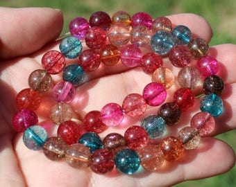 HAS 4 ROUND MULTICOLORED 8 MM TOURMALINE BEADS *.