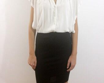 White pleated shirt