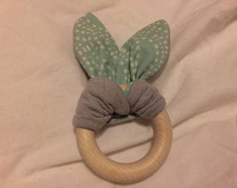 Organic rattle with different textures in fabric bunny ears