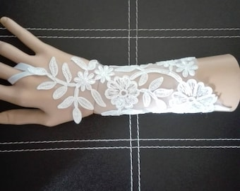 pair of fingerless gloves white lace bridal wedding ceremony