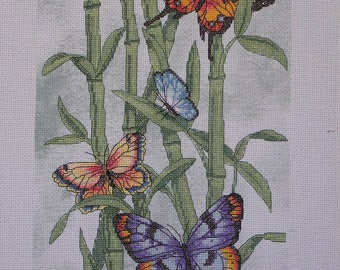 Embroidered butterflies on bamboo