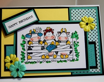 Happy Birthday card sent by Ladies Devine, Handmade Greeting Card featuring stamped image of cows delivering mail in  yellow,green,and black