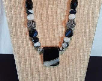 Sophisticated black onyx, gray and white beaded necklace with a perfectly matched stone pendant