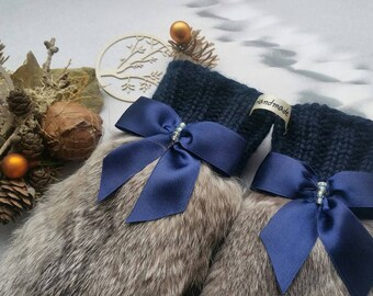 handmade mittens with natural fur.
