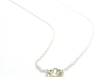 Delicate Abalone silhouette drop necklace in sterling silver and freshwater pearl. Delicate Sterling Silver floral necklace. Dainty necklace
