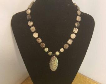 Tourmalinated glass beaded necklace. 244