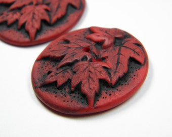 2 Red and Black Maple Leaf Buttons