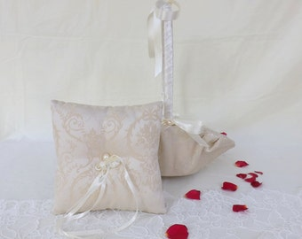 Ivory set of flower girl basket and wedding ring pillow decorated with Ivory pearls and satin ribbon. Ivory patterned fabric.