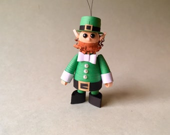 Paper Quilling leprechaun miniature, ready for St. Patrick's Day, with pot of gold