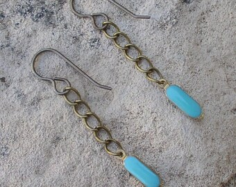 Dark brass chain earrings with bright turquoise drop
