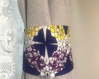 Tie backs. Blue/yellow/purple/white floral print curtain tiebacks