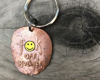 F Off Bullies copper key chain benefits human rights, environment or reproductive rights