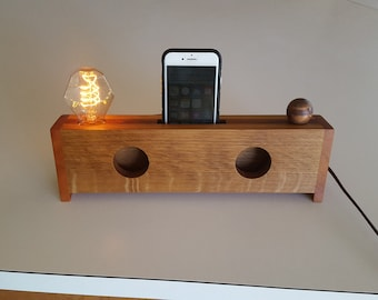 Combination wooden passive cell phone speaker/lamp.