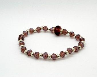 purple glass bracelet with lampworked bead