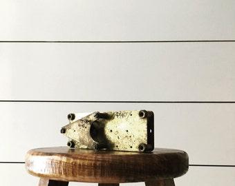 Vintage brass kilowatt gear