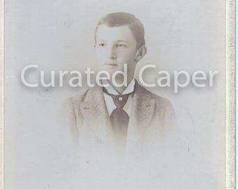 Boy in tie in original vintage photograph