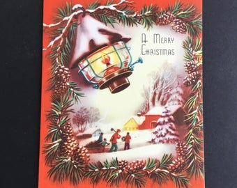 Vintage Christmas greeting card, Lantern, bringing home the tree, by Ideal