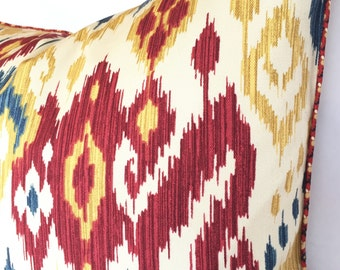 Vibrant Ikat Pillow Cover in Scarlet Red, Denim Blue and Gold on a Parchment Background