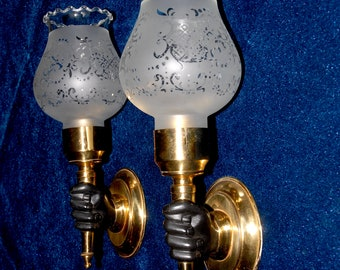 Pair of French vintage sconces in form of hand holding a torch