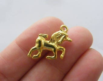 6 Unicorn Charms gold tone GC83