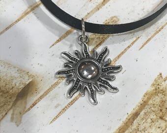 Black chokers with pendants
