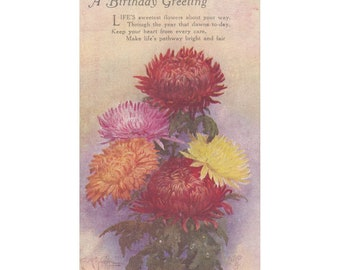 Vintage UK Raphael Tuck Sons postcard. A BIRTHDAY GREETING chrysanthemums, two bronze, a pink, a yellow & an orange