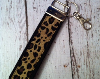 Leopard print key fob wristlet on black cotton webbing with swivel lobster clasp