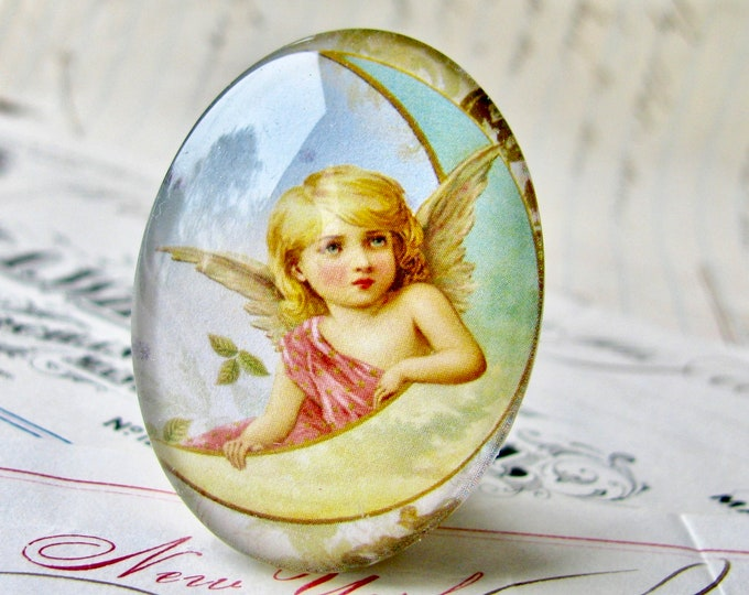 Handmade in this shop, glass oval angel cabochon, 25x18mm or 40x30mm, Victorian angel on the moon, winged cherub, mint, sky blue, yellow
