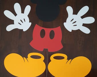 Mickey Mouse heads, gloves, pants and shoe cut outs/silhouettes. 6 pieces.