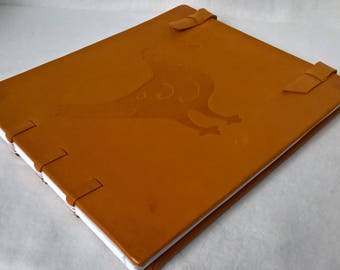 Sketchbook drawing Coptic binding and stamped sheep leather
