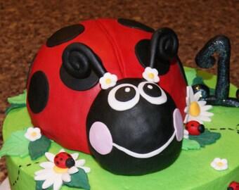 Large fondant ladybug cake topper