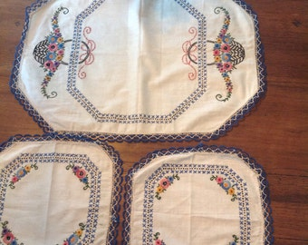 Set of three vintage doilies/dresser scarves .....hand embroidered....1950s