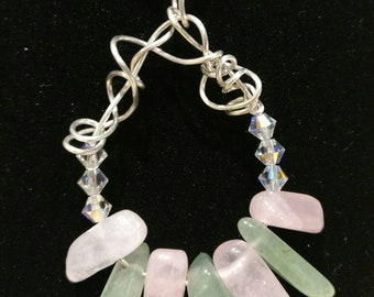 Quirky hand made necklace with green aventurine and rose quartz wrapped in sterling silver and swarovski crystals and snake chain