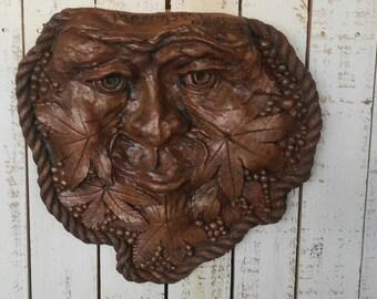 Maple leaf man plaque