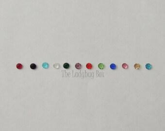 Individual birthstones for locket
