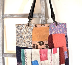 tote bag patchwork stitched handles with black leather, side pocket in front, vintage Kantha fabric, cotton lining, three interior pockets
