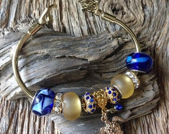 nautical sea turtle bracelet: Gold, yellow, and navy blue nautical bracelet, gold sea turtle bracelet with anchor and wheel, marine jewelry