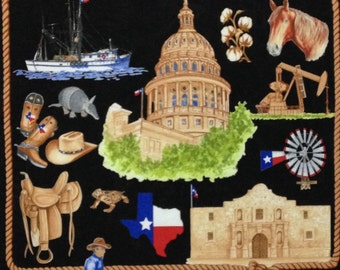 "Texas Our Texas Black cotton panel -- approximately 23"" x 44"""