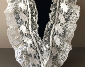 Delicate ruffled white antique lace collar with whitework trim.
