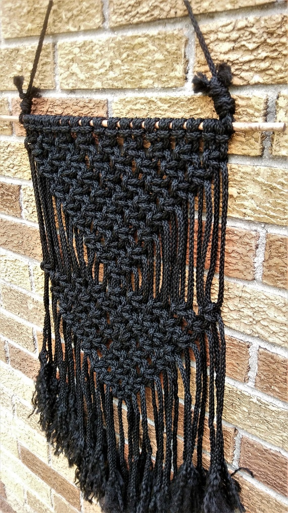 Black Macrame Wall Hanging on a Wooden Dowel