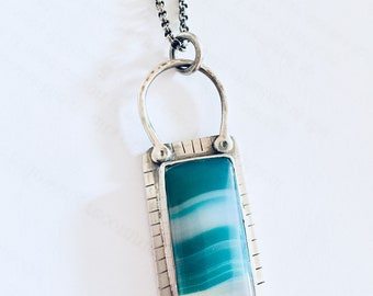 Green striped onyx pendant on sterling silver chain.  Lisa Colby Metalsmith. OOAK
