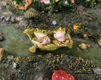 Miniature Frogs in a Leaf Boat