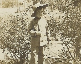 SALE, lil' adventurer, vintage postcard-Antique photo postcard (RPPC) portrait of a little boy in the bushes wearing a hat, paper ephemera.