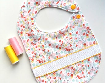 Flower bib with Aida canvas strip for embroidery cross stitched by hand