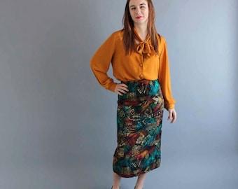 tribal print rayon skirt . mid length skirt . elastic waist skirt . womens M L skirt . slim fit skirt