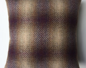 Handmade cushion in purple and cream checked fabric.