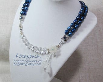 Arctic Bloom; Asymmetrical Magnet Clasp Necklace of Clear Glass, Silver Findings & Striking Deep Blue Freshwater Pearls with Crystal Accents